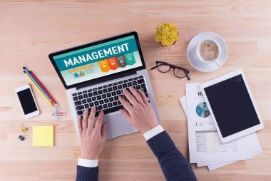 Businessman is working on desk - MANAGEMENT