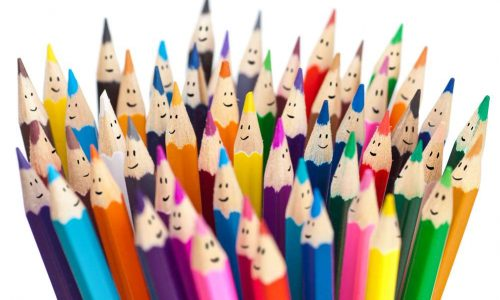 Colorful pencils as smiling faces people isolated. Social networking communication concept.