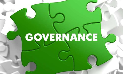 Governance on Green Puzzle on White Background.