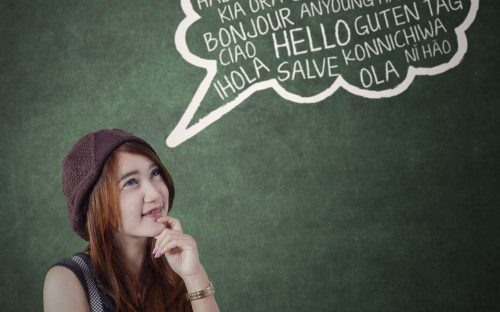 Female high school student learning different languages in the classroom