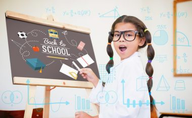 Maths against cute pupil dressed up as scientist in classroom